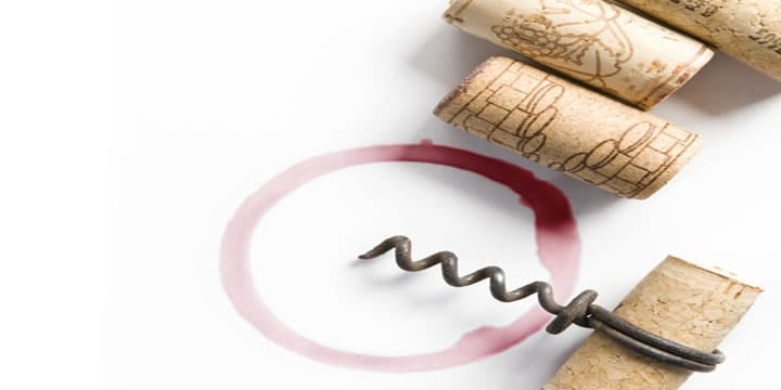Wine corks, small corkscrew, red wine